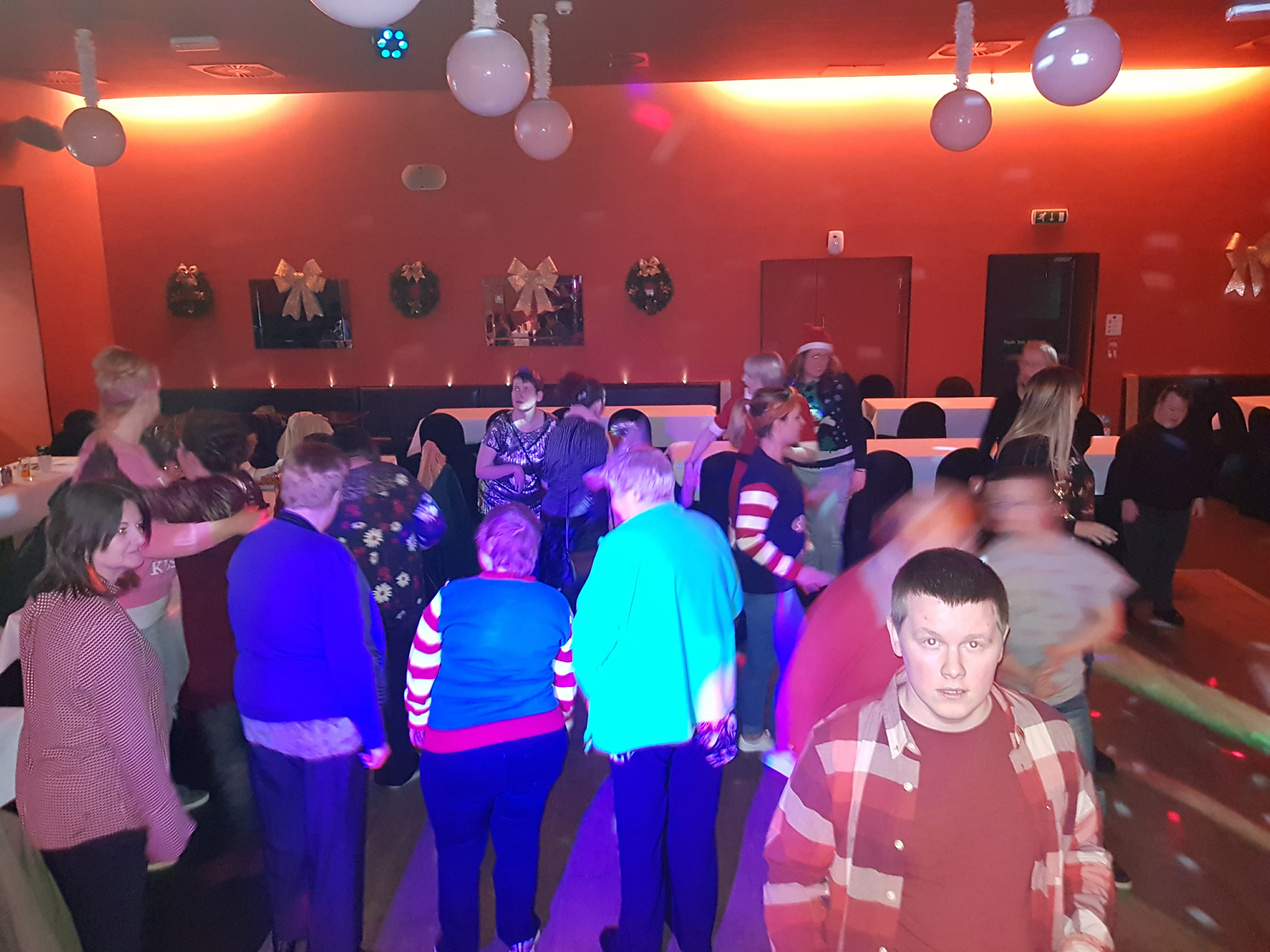 People dancing at the 2017 Christmas party for COJAC service users