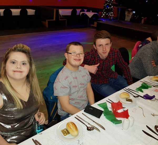 Young adult users of the COJAC service having a meal at the 2017 COJAC service user party
